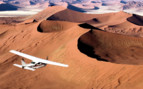 Plane over dunes at Scheoneman Skeleton Coast Flying Safaris, luxury camp in Namibia