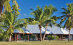 Bird Island chalets exterior and palm trees