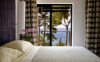 Bedroom with sea view at Monte Mulini, luxury hotel in Croatia