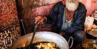 Indian man cooking in the street in Rajasthan