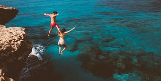 People Jumping Off a Cliff