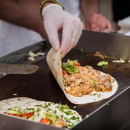 Making tacos at a food market