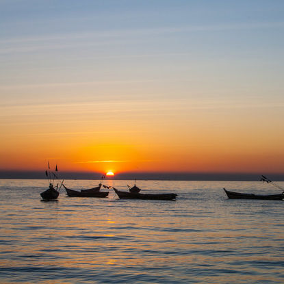 Canoes on the Irrawaddy River during Sunset