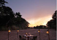 Dinner on the sandriver at Jongomero, luxury hotel in Tanzania