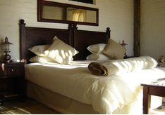 Bedroom at Desert Homestead, luxury camp in Namibia
