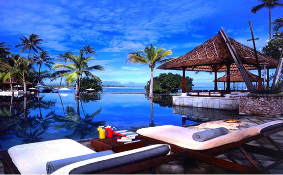 Oberoi Lombok swimming pool and sun beds
