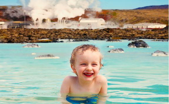 Smiling boy in the Blue lagoon