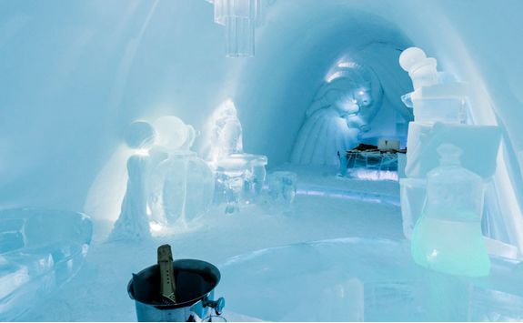 Enjoy champagne in the Icehotel room