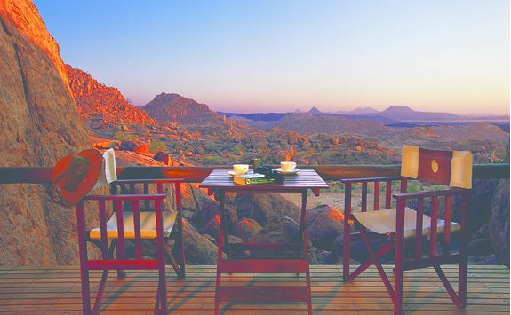 Table and chairs with a view at Mowani
