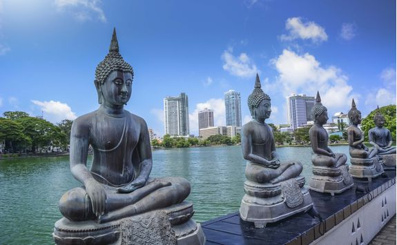 Buddha statues on the Colombo riverbank