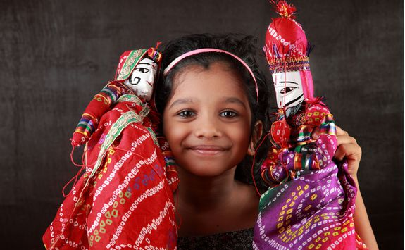 Udaipur girl with puppets