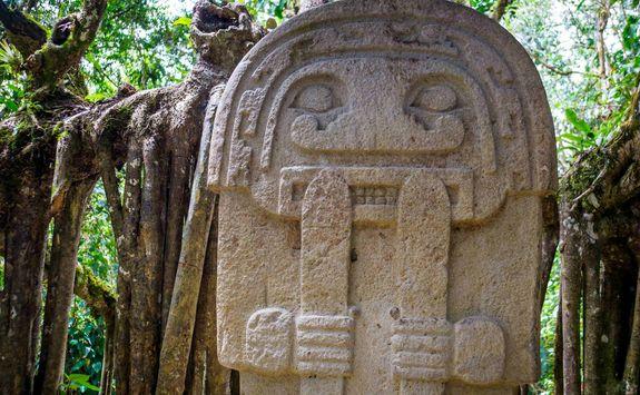 Statue in rainforest