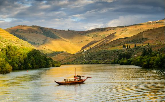 Boat cruising along the river Douro