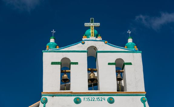a colourfully painted church in Chamula
