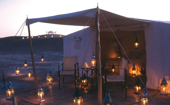 Dar Ahlam tent at night with candles