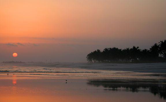 sunset on a beach in Salalah
