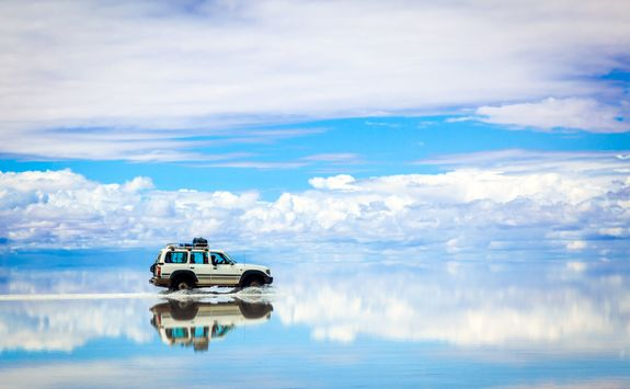 Car driving across the salt flats