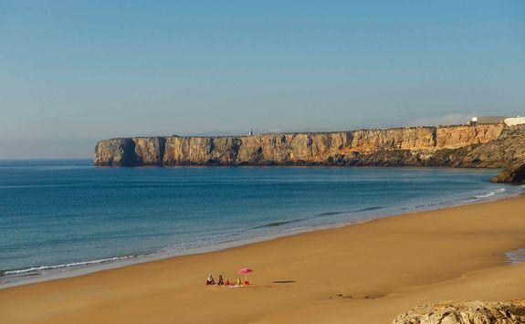 a family on a beach in the Algarve