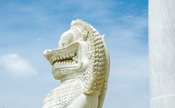 Marble lion guarding temple