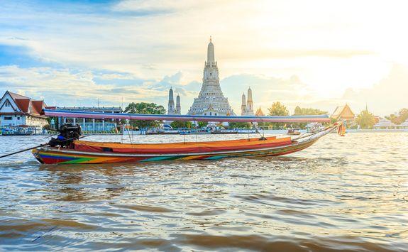 Wat Arun and river boat