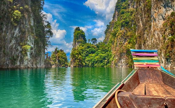 A long tail boat on a lake
