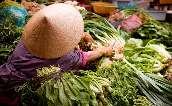 Woman selling vegetables at market