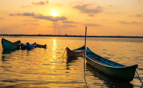 Small fishing boats at sunset