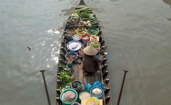 A woman in floating market Cai Rang, Can Tho