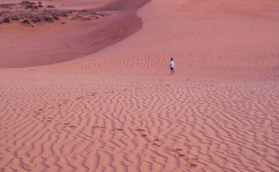 Child in the desert dunes