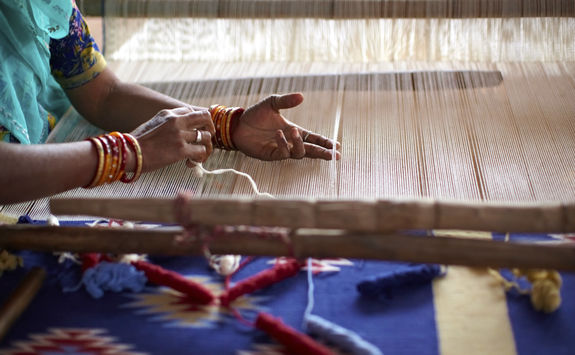 Woman weaving by hand