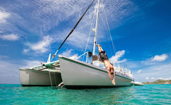 Man diving off a boat