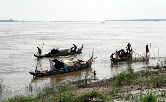 Men fishing on Mekong River