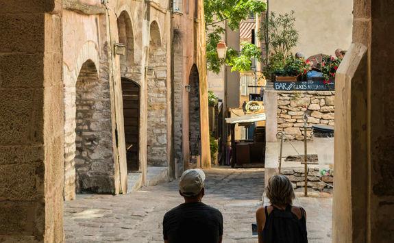Couple in an old street of Bonifacio