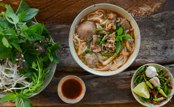 pho vietnames beef soup on a wooden background