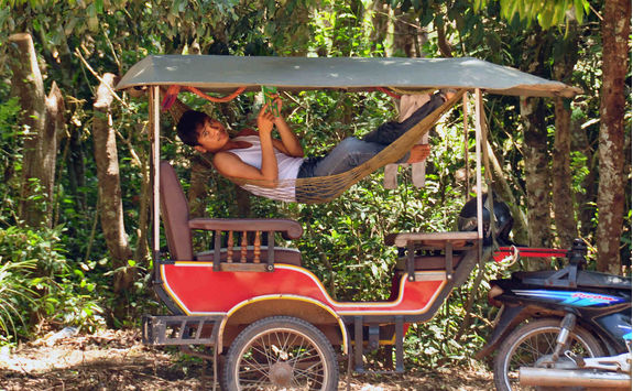 man chilling hammock of tourist carriage