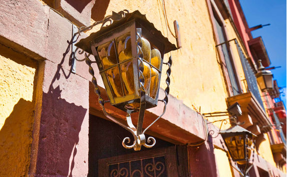 Colourful floor lamp in historic city center