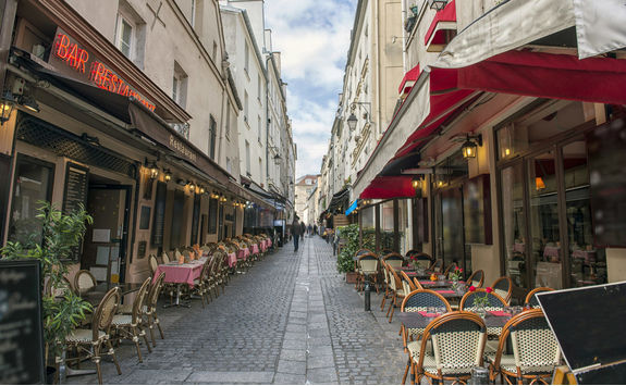 Empty dining tables and chairs in Paris