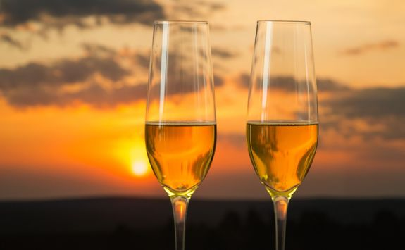 two champagne cup and sunset