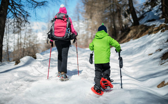 Woman and child snowshoeing outdoor