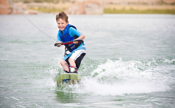 Child learning to wake-board