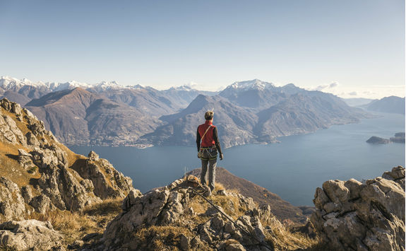 Hiker on top of the mountain above Lake Como