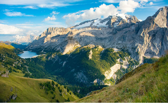 View to Marmolada and Fedaia lake in the Dolomites