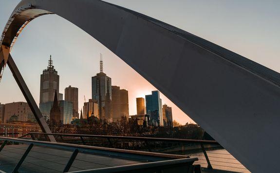 Melbourne cityscape framed by walker pedestrian