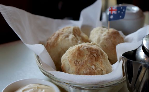 Scone with butter and jam and an Australian flag