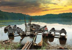 tamblingan lake boats at sunset