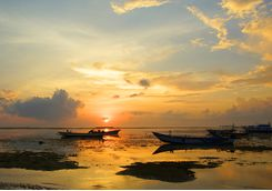Boats in the ocean on Sanur beach