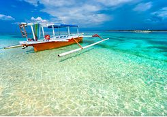 Boat in the clear gili islands ocean