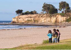 children exploring santa barbara beach