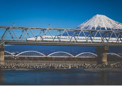 Bullet train speeding past Mount Fuji