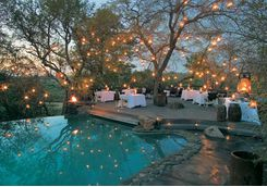 singita boulders pool lit by fairy lights